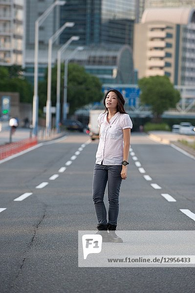 Japanese Girl poses on the street in Yokohama  Japan. Yokohama is a port city located in a bit south of Tokyo.