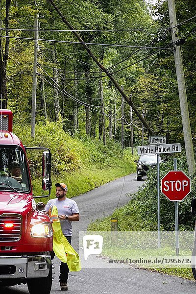 Sharon  Connecticut  USA Fire department and emergency personel on a country road due to downed power lines.
