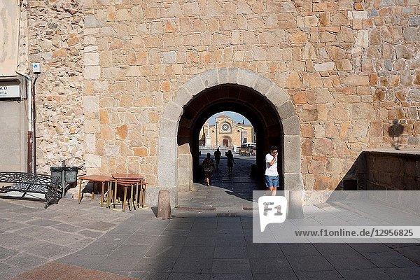 San Pedro Church at the Mercado Grande Square through an arch. Avila  Community of Castilla-León  Spain  Europe.