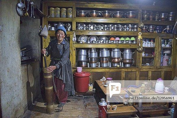 Old woman making Tibetan butter tea  Lamayuru  Ladakh  India.