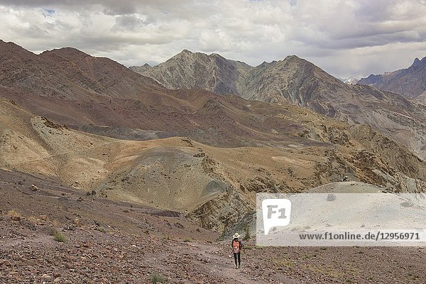 Descending to the Zanskar River with approaching storm  Ladakh  India.