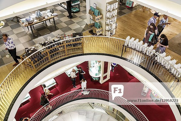 United Kingdom Great Britain England  London  West End St James's  Piccadilly  Fortnum & Mason  shopping  inside interior  luxury upmarket department store  mezzanine overhead view atrium stairs  railings