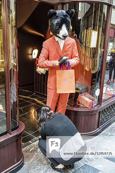 United Kingdom Great Britain England  London  Mayfair  Burlington Arcade  shopping  upmarket luxury covered pedestrian arcade  stores  Atkinsons  British perfume house  window dresser  woman  bear mascot  humor humour