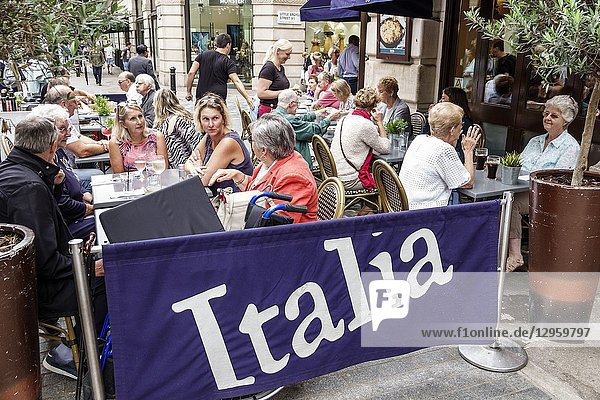 United Kingdom Great Britain England  London  Soho  Bella Italia  restaurant  Italian  alfresco dining sidewalk seating  tables  man  woman