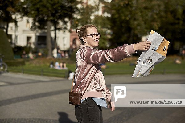 Woman with city guide map  in Berlin  Germany
