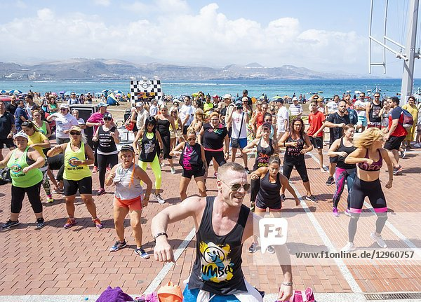 Zumba class overlooking Las Canteras beach in Las Palmas  the capital of Gran Canaria. Canary Islands  Spain.