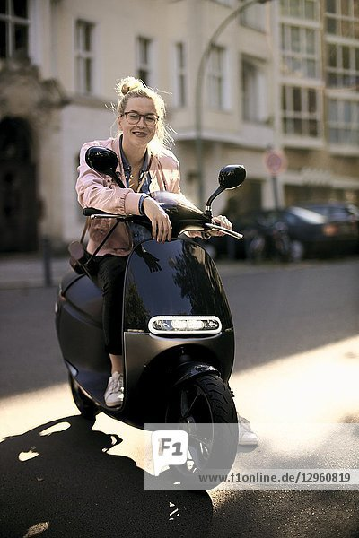Woman on motor scooter  in Berlin  Germany