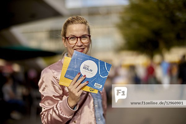 Woman with city tour guide maps in Berlin  Germany