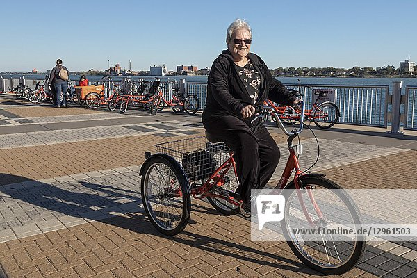 Detroit  Michigan - People try out adaptive bicycles  now offered through MoGo  Detroit's bike share system. The adaptive bikes are designed for people who can't ride a standard two-wheeler. They include hand tricycles  recumbent tricycles  tandem bicycles  cargo tricycles  and more.