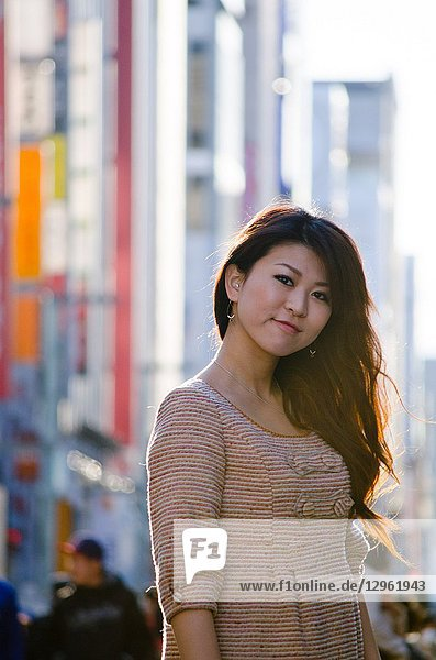Japanese Girl poses on the street in Ginza  Japan. Ginza is a shopping city located in Tokyo.