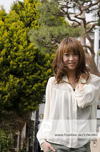 Japanese Girl poses on the street in Jiyugaoka  Japan. Jiyugaoka is a town located in Tokyo.