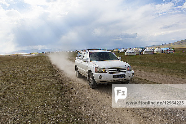 Four wheelers vehicle at a festival organized for nomadic games on the shores of Lake Song Kol  Kyrgyzstan