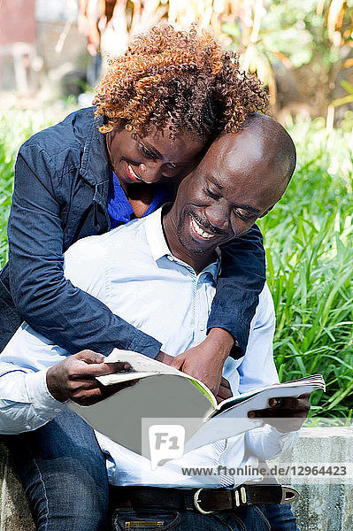 This young couple is happy to be together that day in the park.