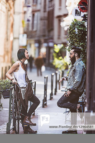 Young hipster couple in full discussion