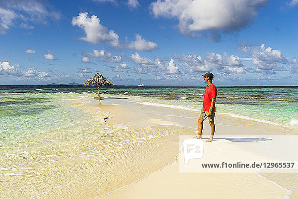 A man standing on the Morpion's island beach  St-Vincent  Saint Vincent and the Grenadines  Lesser Antilles  West Indies  Windward Islands  Caribbean  Central America