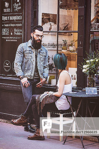 Young hipster couple walking down the street