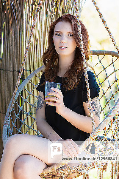 Young woman sitting in a fruit juice