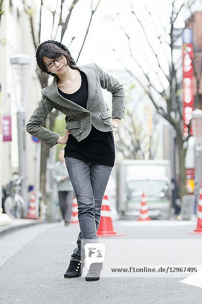 Japanese Girl poses on the street in Toranomon  Japan. Toranomon is a business district in Tokyo.