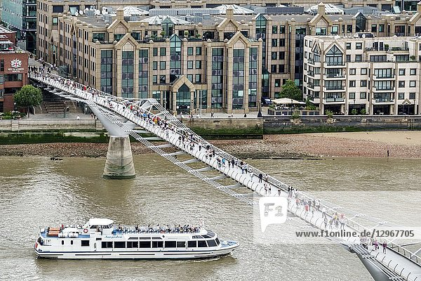 United Kingdom Great Britain England  London  Bankside  River Thames  Tate Modern art museum terrace view  Millennium Bridge  suspension footbridge  pedestrians crossing bridge  sightseeing boat Sarpedon