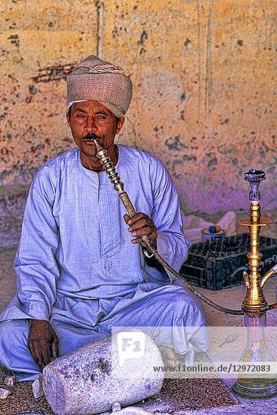 Man smoking water pipe in Cairo Egypt