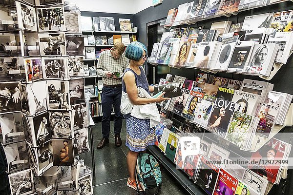 United Kingdom Great Britain England  London  Soho  The Photographers' Gallery  store  gift shop  shopping  magazines  cards  woman  man  reading  looking  blue hair
