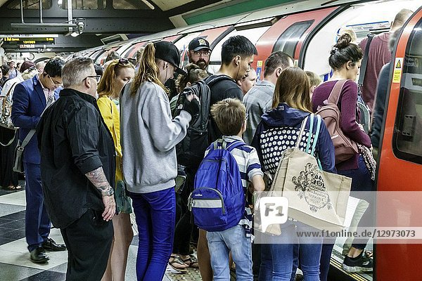 United Kingdom Great Britain England  London  Lambeth South Bank  Waterloo Underground Station  subway tube  public transportation  platform  boy  woman  man  passenger  commuter  boarding  train