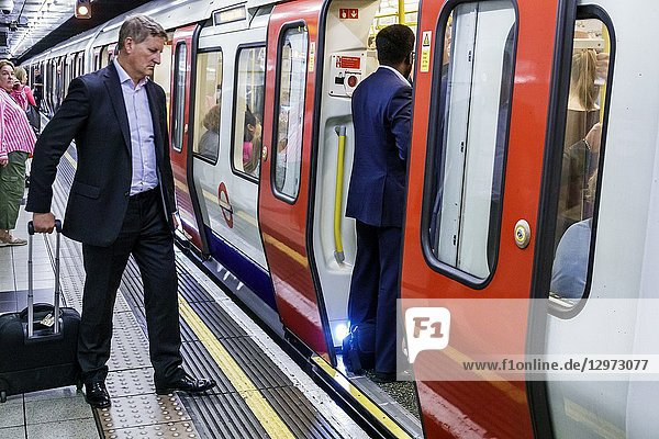 United Kingdom Great Britain England  London  Lambeth South Bank  Waterloo Underground Station  subway tube  public transportation  platform  man  passenger  commuter  train  boarding