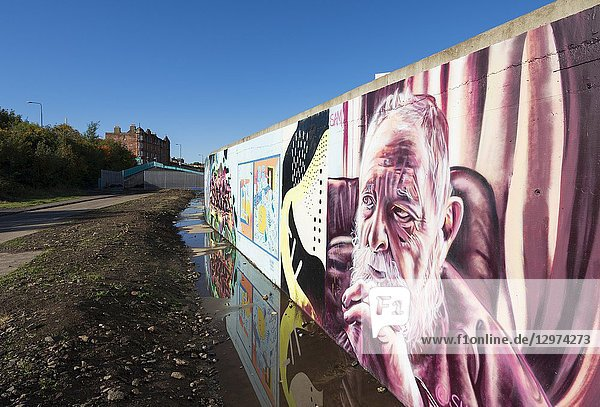 View of murals painted on wall at Marine Parade Graffiti Wall in Leith   Scotland .