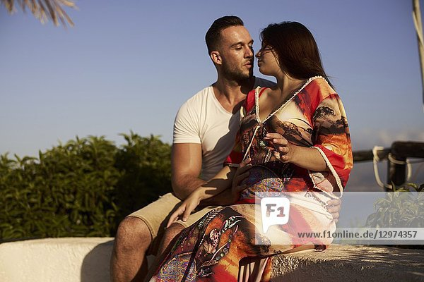 Young couple  pregnancy  outdoors