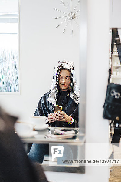 Hairdressing client with foil in hair in Sweden