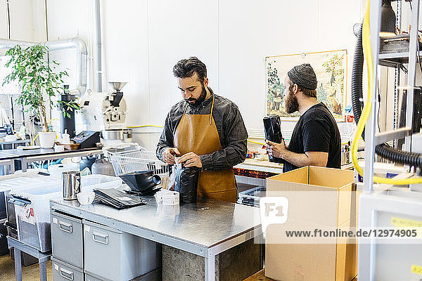 Two men making coffee in a commercial kitchen in Sweden