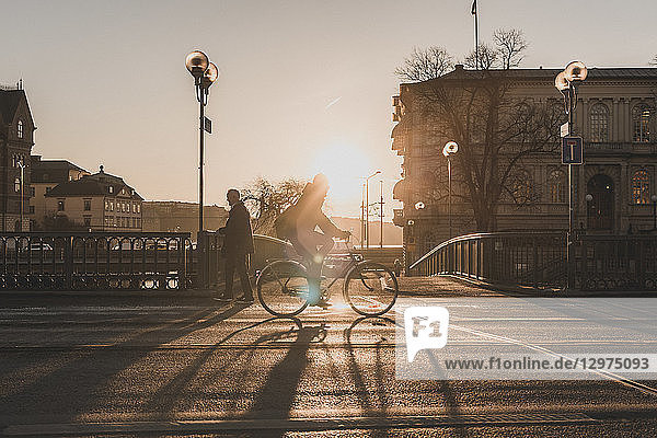Man bicycling at sunset in Stockholm  Sweden