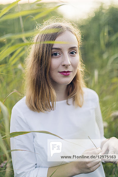 Young woman standing in a field of grass in Karlskrona  Sweden