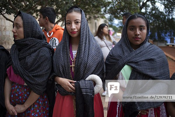 Young women dressed with traditional clothing during a religious celebration outside the Templo de Santo Domingo church in Oaxaca  Mexico.