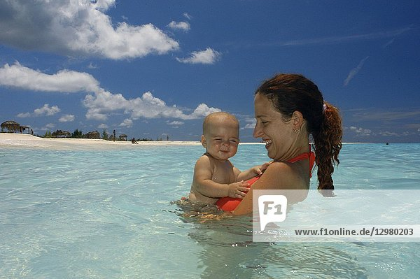 Mother with her doughter in Paradise Beach  Cayo Largo del Sur  Cuba.