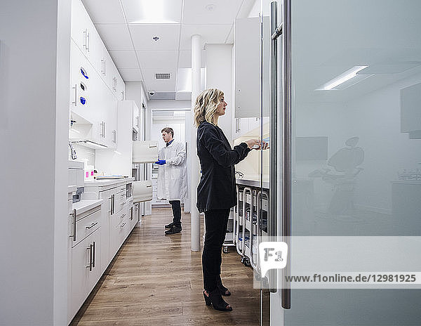Dentist and assistant in sterilization room
