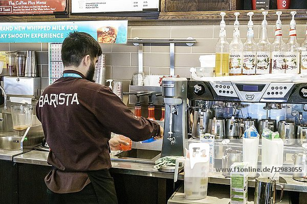 England  London  Lambeth South Bank  Costa Coffee  cafe  coffeehouse  barista  espresso machine  making beverage  man  counter attendant  employee worker working