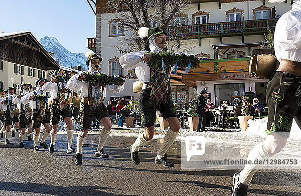 Germany  Bavaria  Mittenwald  traditional carnival procession  'Unsinniger Donnerstag'  bell stirrers