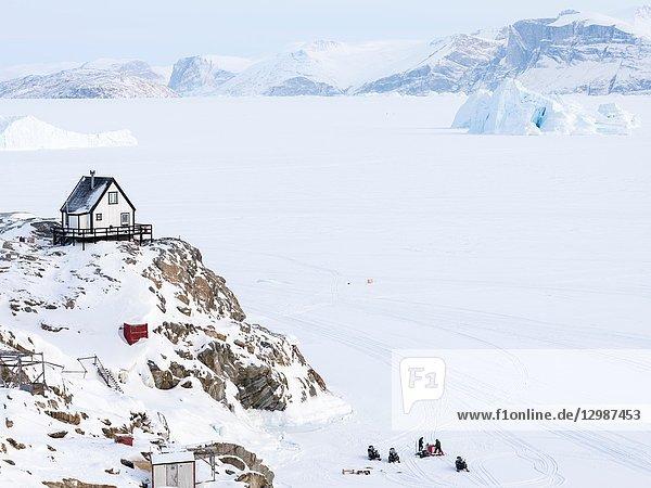 Town Uummannaq during winter in northern Greenland. Background is Nussuaq (Nugssuaq) peninsula. America  North America  Denmark  Greenland.