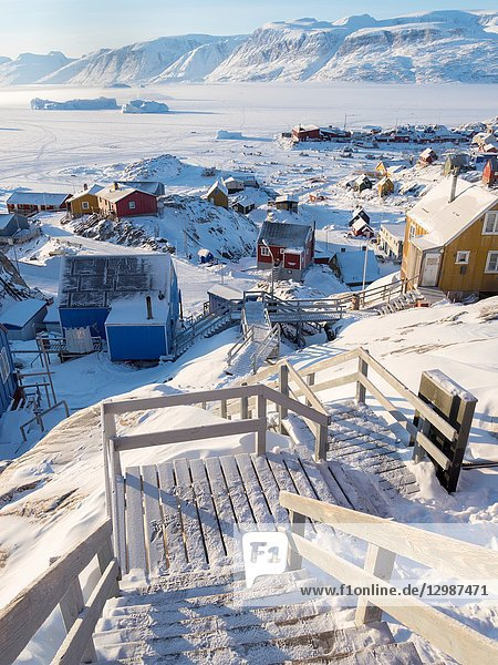 Town Uummannaq during winter in northern Greenland. Background is Nussuaq (Nugssuaq) peninsula. America  North America  Denmark  Greenland.