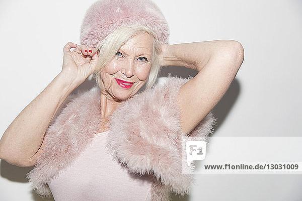 Portrait smiling  elegant senior woman wearing pink fur Portrait smiling, elegant senior woman wearing pink fur