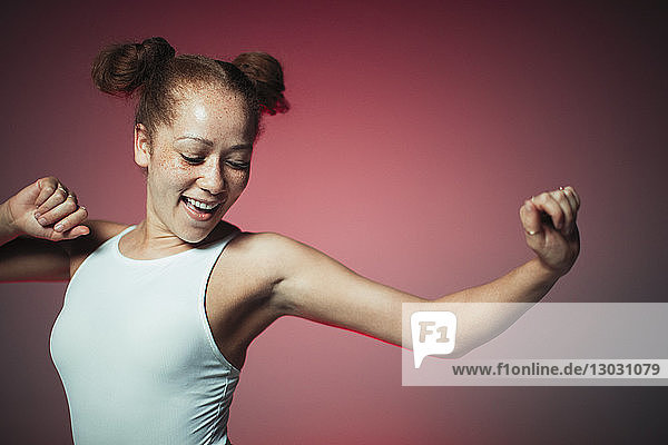 Carefree young woman dancing