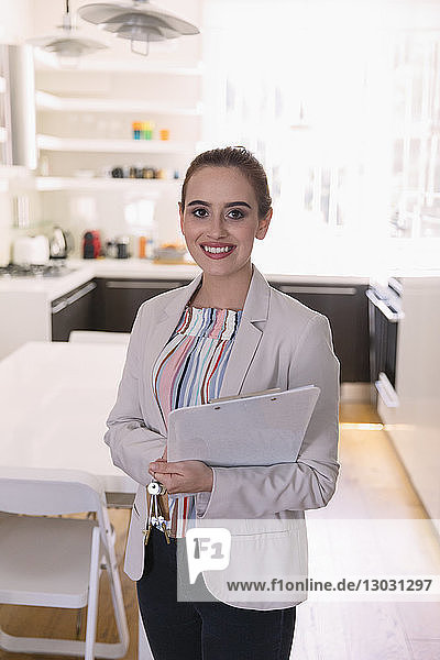 Portrait smiling  confident female real estate agent in kitchen