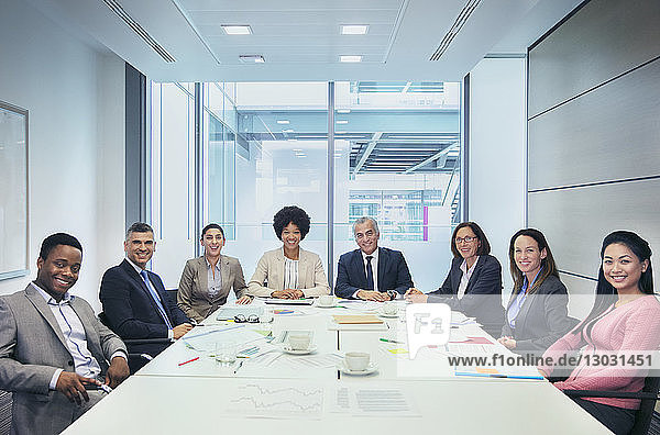 Portrait confident business people in conference room meeting