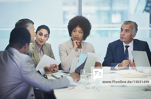 Attentive business people listening in conference room meeting
