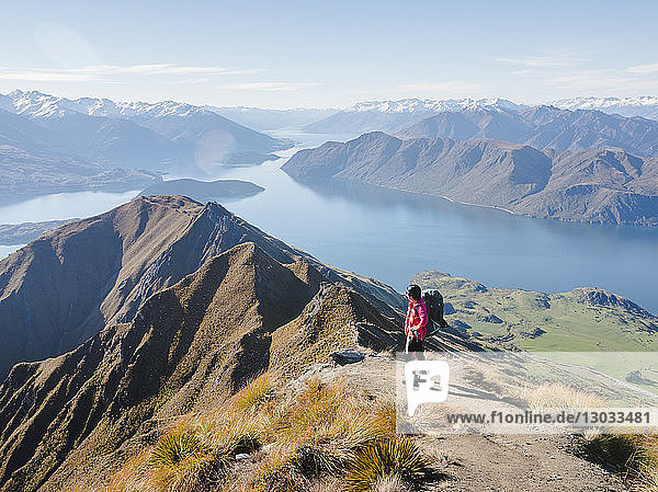 Woman hiker enjoying the view from the Roys Peak trail near Wanaka  Otago  South Island  New Zealand  Pacific