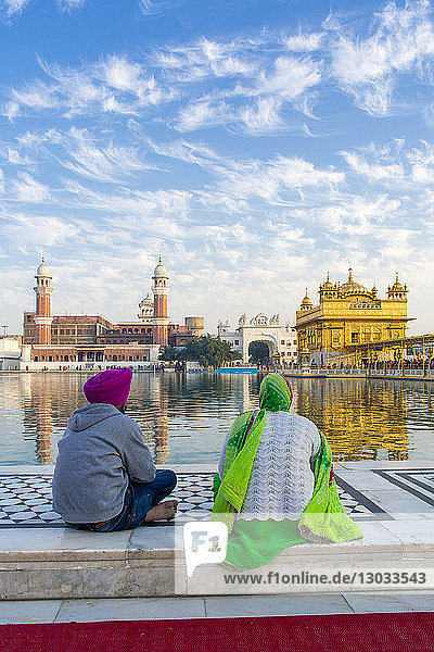 Sikhs at The Golden Temple (Harmandir Sahib) and Amrit Sarovar (Pool of Nectar) (Lake of Nectar)  Amritsar  Punjab  India