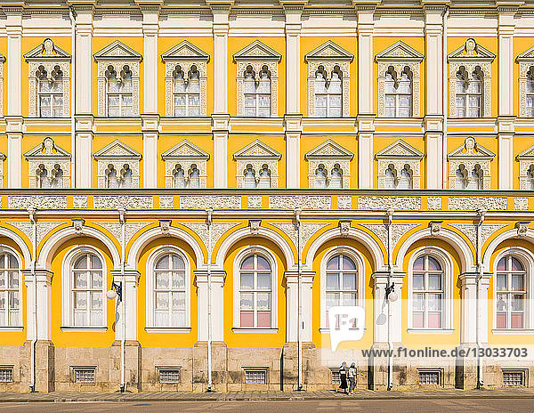 Two women walking in the Kremlin in front of Grand Kremlin Palace  UNESCO World Heritage Site  Moscow  Russia
