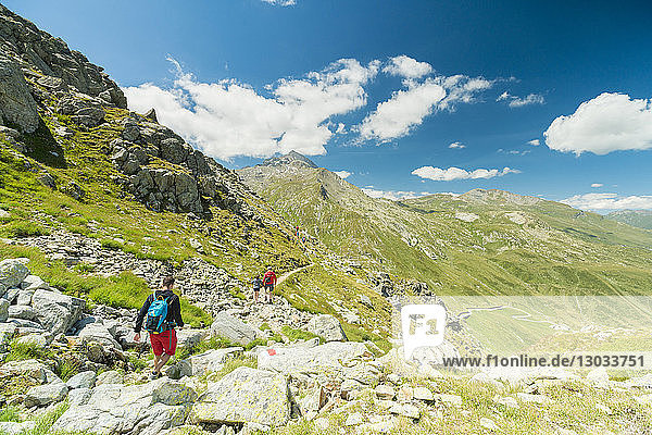 Hikers on footpath towards Pizzo Tambo  Spluga Pass  canton of Graubunden  Switzerland
