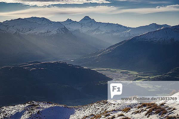 Hiking along the mountain ranges with a view of Mount Aspiring  Otago  South Island  New Zealand  Pacific